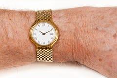 wrist för white för watch för framsidaguld hårig Arkivfoto