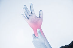 Wrist injury in humans .wrist pain,joint pains people medical, mono tone highlight at wrist Royalty Free Stock Photos