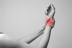 Wrist injury woman holds a hand on her pain wrist. Royalty Free Stock Image