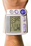 Wrist mounted Blood Pressure Monitor. Showing a normal pressure reading Royalty Free Stock Images