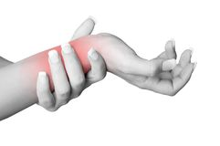 Wrist Pain. Female with pain in her wrist, isolated in a white background. Red circle around the painful area Stock Photo