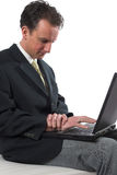 Wrist pain. Man rubbing his wrist Royalty Free Stock Images