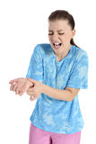 Wrist pain. Beautiful young woman has pain in ankle Royalty Free Stock Photography