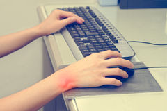 Wrist pain from working with computer Royalty Free Stock Photography