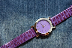 Wrist steel watch on jeans Stock Images