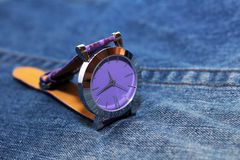 Wrist steel watch on jeans Royalty Free Stock Photography