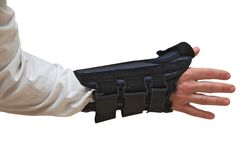 Wrist and Thumb Brace / Splint (back view). Wrist and Thumb Brace / stabilizer / splint for wrist fracture or carpel tunnel syndrome.  Isolated on white Stock Photo