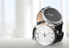 Two wrist watches on light background. Wrist two watches black dial group white objects Royalty Free Stock Images