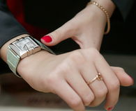 Wrist-watch. Female hands and wrist-watch Stock Image