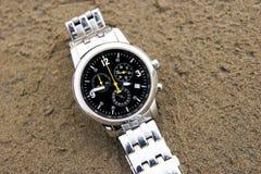 Wrist watch. Fashion multifunctional wrist watch,black watch face and silver white wrist Stock Photos