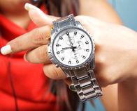 Wrist watch. Female hand holding branded wrist watch Stock Image