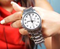 Wrist watch. Female hand holding branded wrist watch stock image