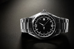 Wrist watch. Titanium wrist watch with black dial. Black background stock images