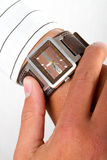 Wrist watch. A man checking the time on his wrist watch Stock Photo
