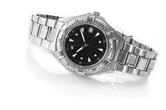 Wrist Watch. Chrome and black wrist watch, casting reflection on white Royalty Free Stock Photo