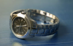 Wrist Watch. Ladies stainless steel watch on a blue wood table royalty free stock photos