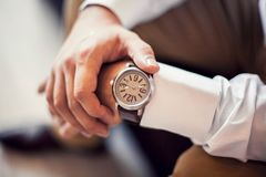 Wrist watch with brown strap Royalty Free Stock Photography