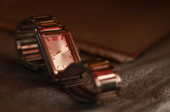 Wrist watch. Clock in the setting sun Stock Photography