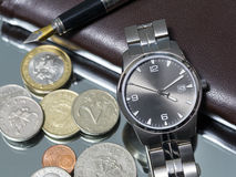 Wrist watch. coin. close Stock Image