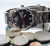 Wrist watch. coin. Royalty Free Stock Photos