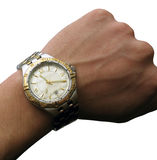 Wrist watch on hand isolated Royalty Free Stock Images