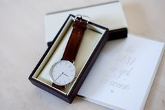 Wrist watch with leather band. Groom`s gift of wrist watch with leather band in box with card - `the best is yet to come royalty free stock images