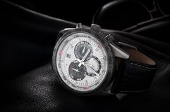 Wristwatch. Wrist watch lie on a jacket with glasses Royalty Free Stock Photos