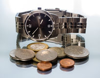Wrist Watch. metal coin. Royalty Free Stock Photography
