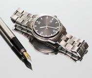 Wrist Watch. pen. close Stock Photos