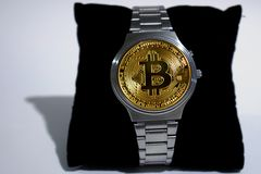 Wrist watch screen bitcoin. Crypto, Concept business, idea: time to earn, buy or sell bitcoin stock image