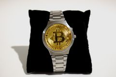Wrist watch screen bitcoin. Crypto, Concept business, idea: time to earn, buy or sell bitcoin royalty free stock images
