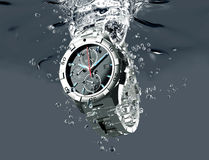 Wrist watch is splashing in water Stock Photography