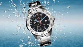 Wrist watch is splashing in water Royalty Free Stock Image
