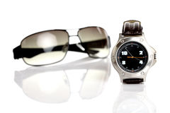 Wrist watch & sunglasses Stock Photography