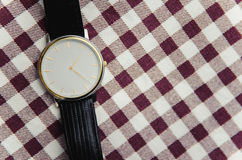 Wrist watch on a textile background Royalty Free Stock Image