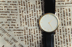 Wrist watch on a textile background Stock Photo