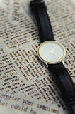 Wrist watch on a textile background Royalty Free Stock Photo