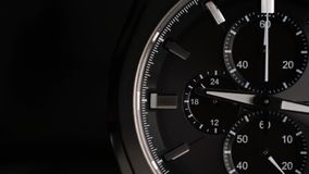 Wrist watch time lapse close up on a black background. white clock hands. Wrist watch time lapse close up on a black background stock video