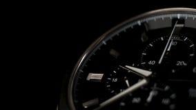 Wrist watch time lapse close up on a black background. white clock hands. Wrist watch time lapse close up on a black background stock video footage