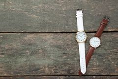 Wrist watches. On grey wooden table royalty free stock images