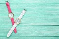 Wrist watches. On mint wooden table stock image