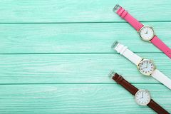 Wrist watches. On mint wooden table stock photography