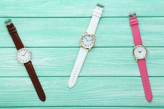 Wrist watches. On mint wooden table stock photos