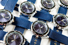 Same a blue man's watch with blue fabric thongs Stock Image