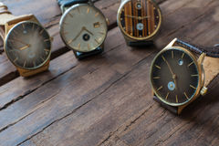 Wrist watches on a wooden table. Vintage Wrist watches on a wooden table Royalty Free Stock Photos