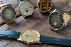 Wrist watches on a wooden table. Vintage Wrist watches on a wooden table Stock Image