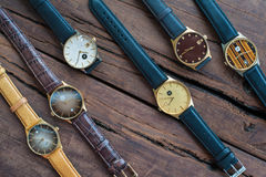 Wrist watches on a wooden table. Vintage Wrist watches on a wooden table royalty free stock images
