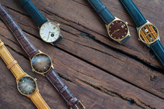 Wrist watches on a wooden table. Vintage Wrist watches on a wooden table Stock Photos