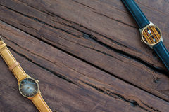 Wrist watches on a wooden table. Vintage Wrist watches on a wooden table Stock Images