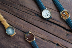 Wrist watches on a wooden table. Vintage Wrist watches on a wooden table Royalty Free Stock Image